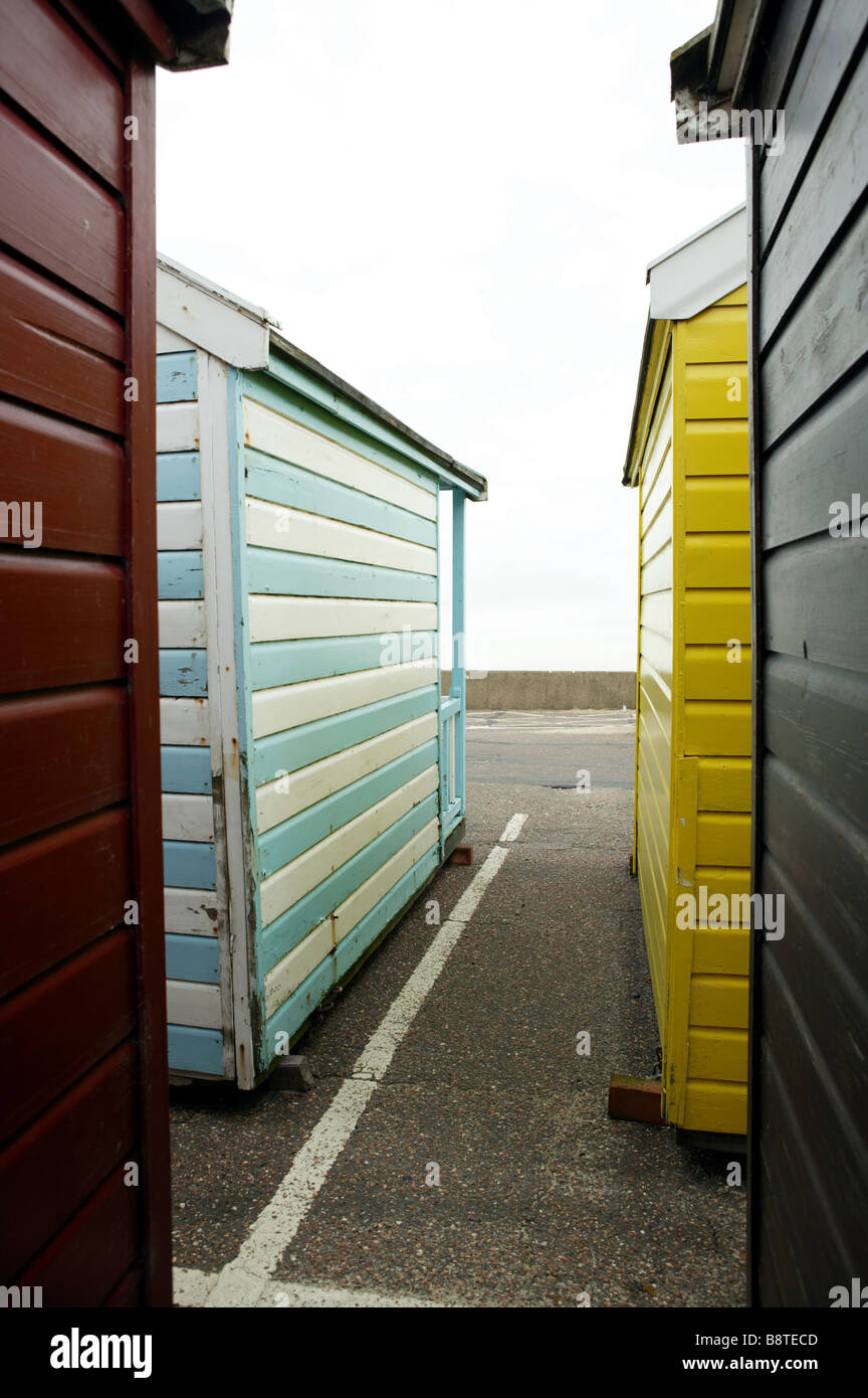Beach huts placed in car park for storage during the winter months giving an unusual graphic illustration of life - Stock Image
