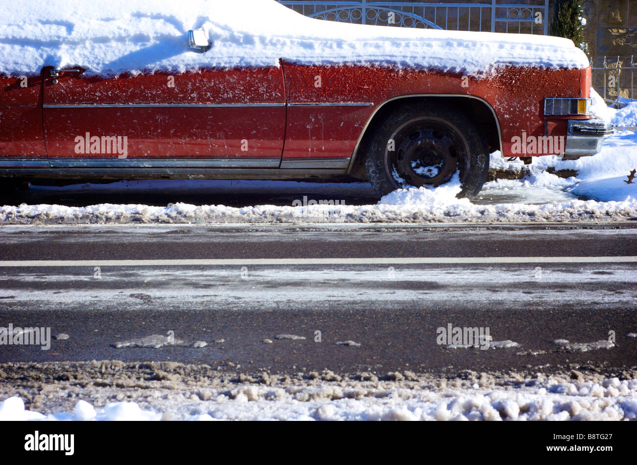 Old Cadillac Buried in Snow on a Cold WInter Day Stock Photo
