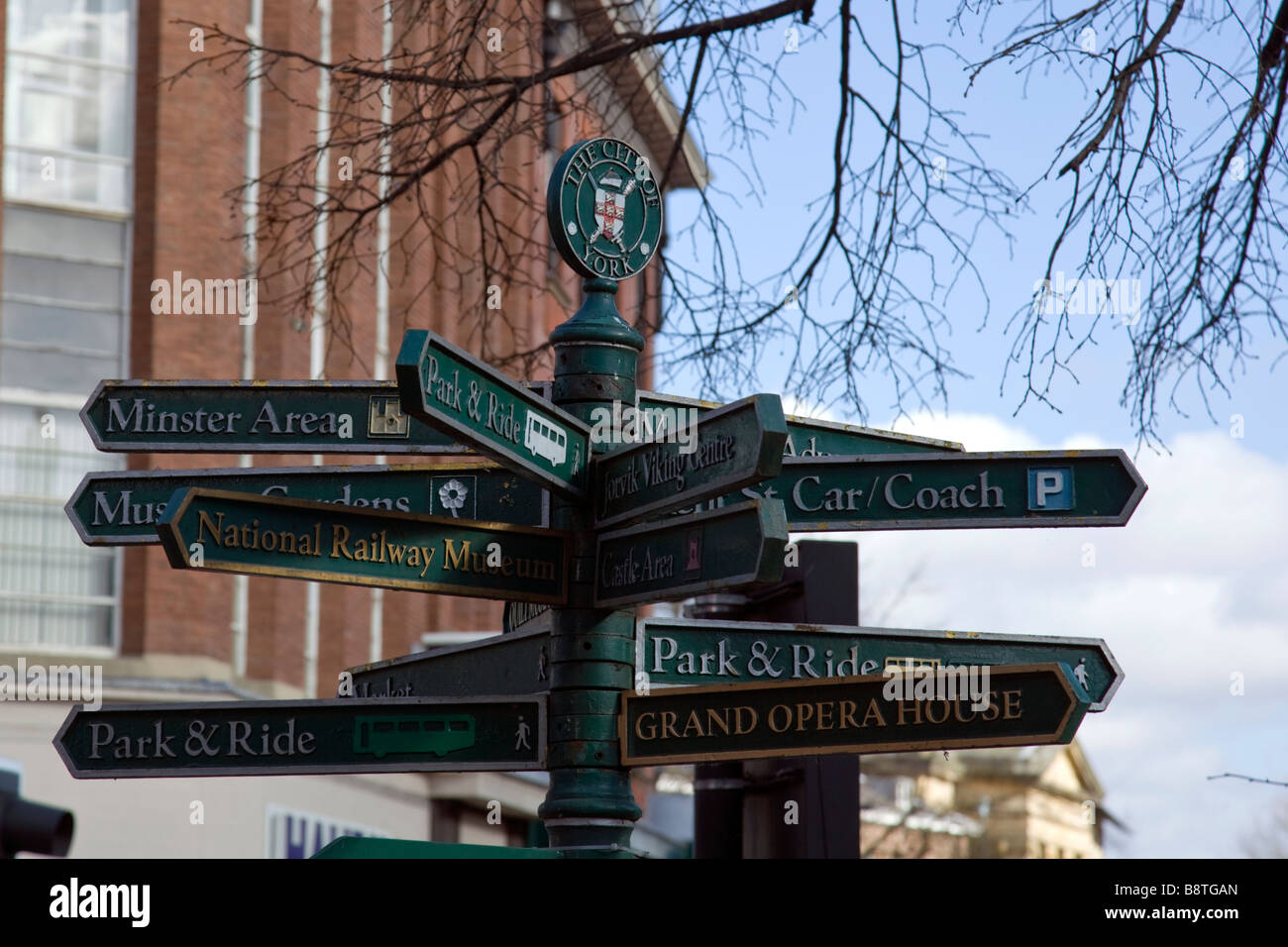 tourist signpost showing directions to popular attractions the shambles york north yorkshire england uk - Stock Image