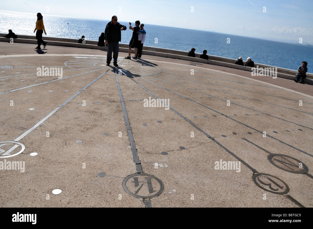 Nice, France, 'Beach Scene', French People Promenading at Huge Sundial on Sidewalk near 'Mediterranean - Stock Image
