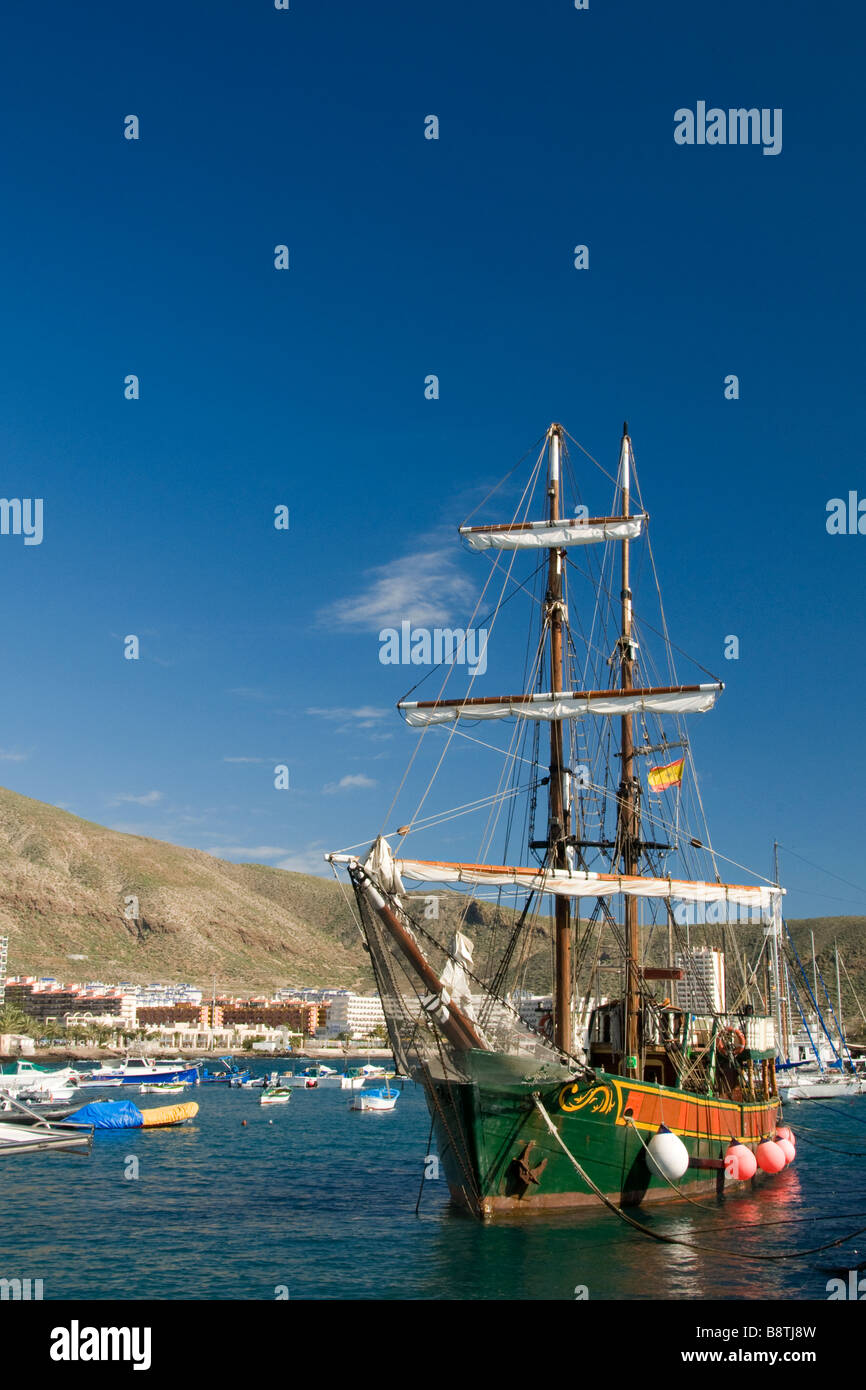 The 'Jolly Roger' pirate party tour boat flying the Spanish flag in Los Cristianos harbour Tenerife Canary - Stock Image