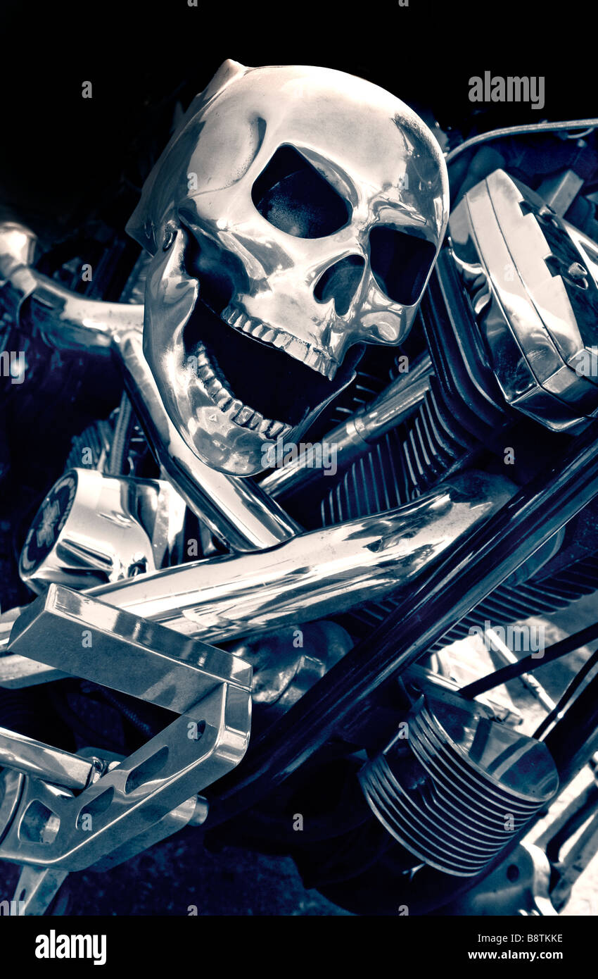 Hand made custom metal skull accessory attached to the polished chrome on a Harley-Davidson Motorcycle - Stock Image