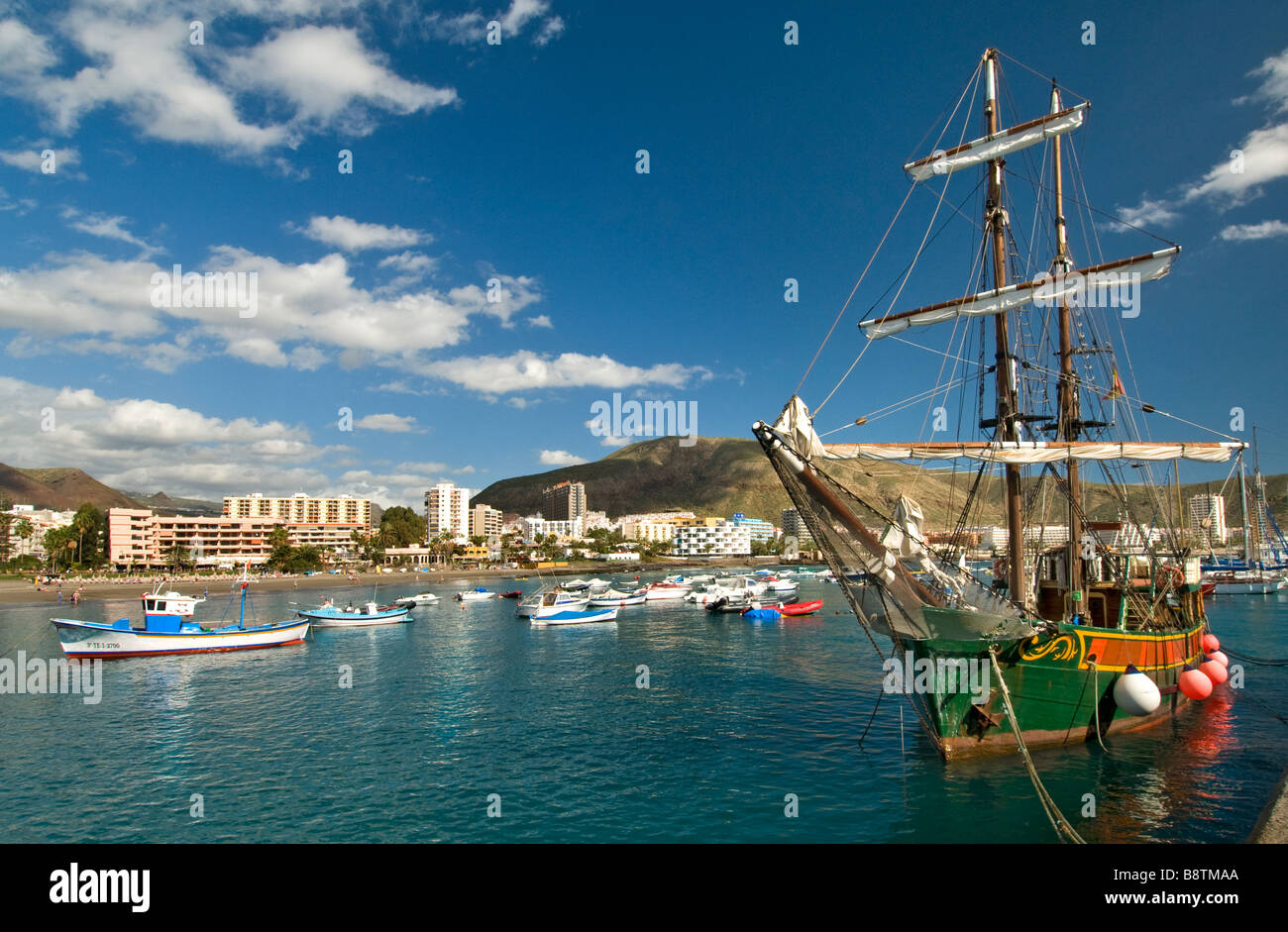 The 'Jolly Roger' pirate themed tour boat in Los Cristianos harbour Tenerife Canary Islands Spain - Stock Image