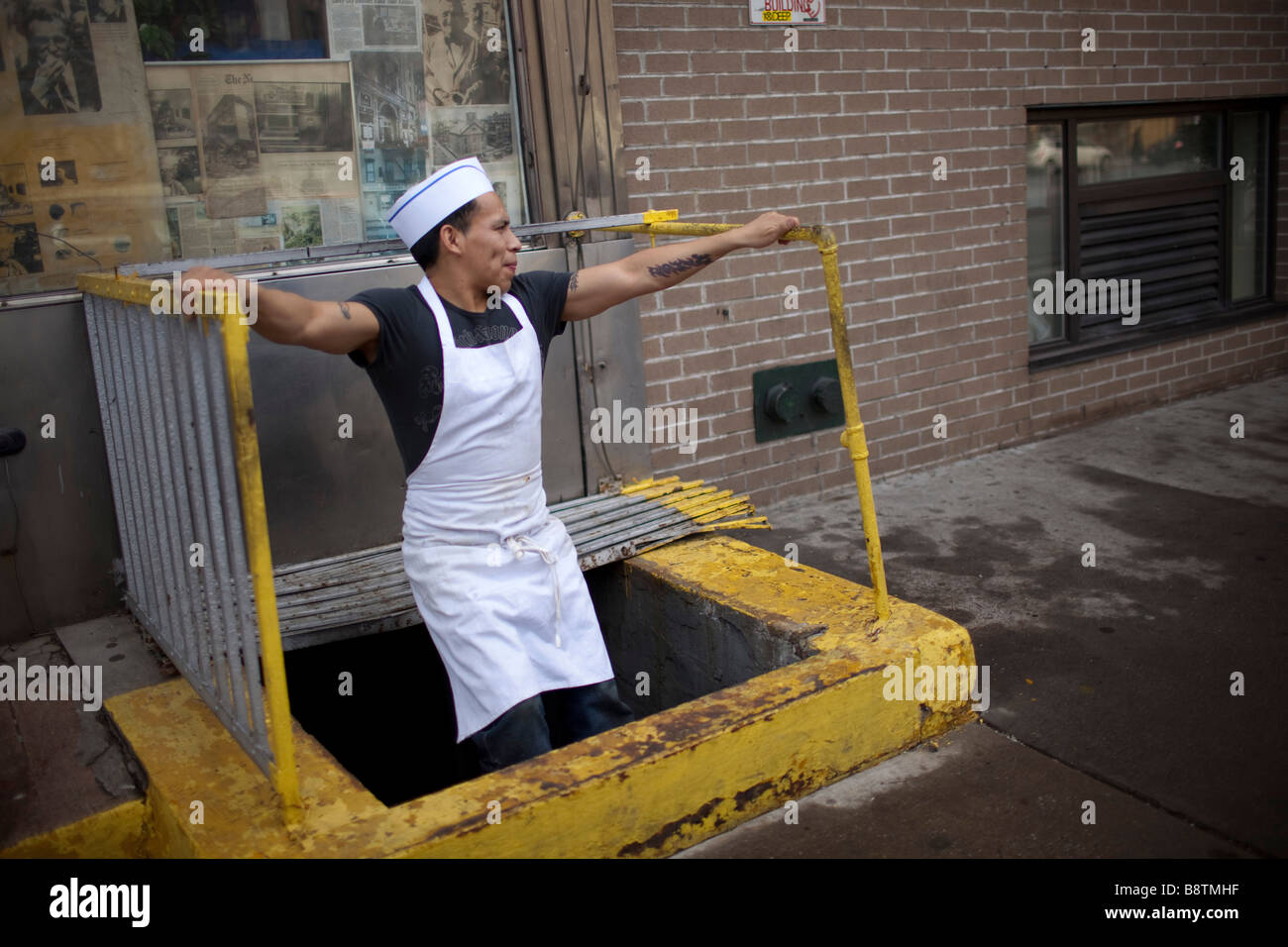 Busboy takes a breather - Stock Image