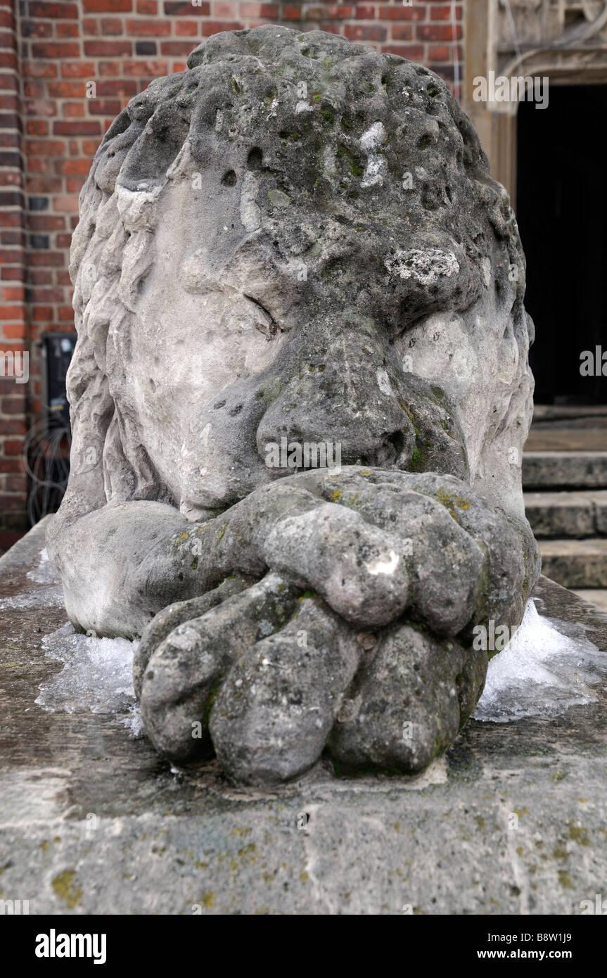 sleeping lion stone sculpture carving outside guard guarding asleep Town Hall Tower in Rynek Krakowski Kraków - Stock Image