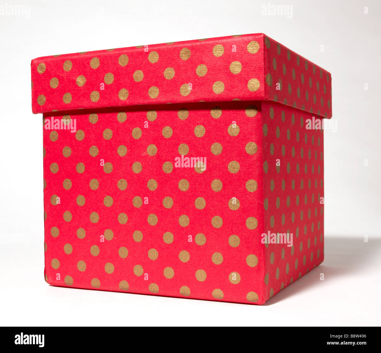 Red and Gold Polka Dot Gift Box Present - Stock Image