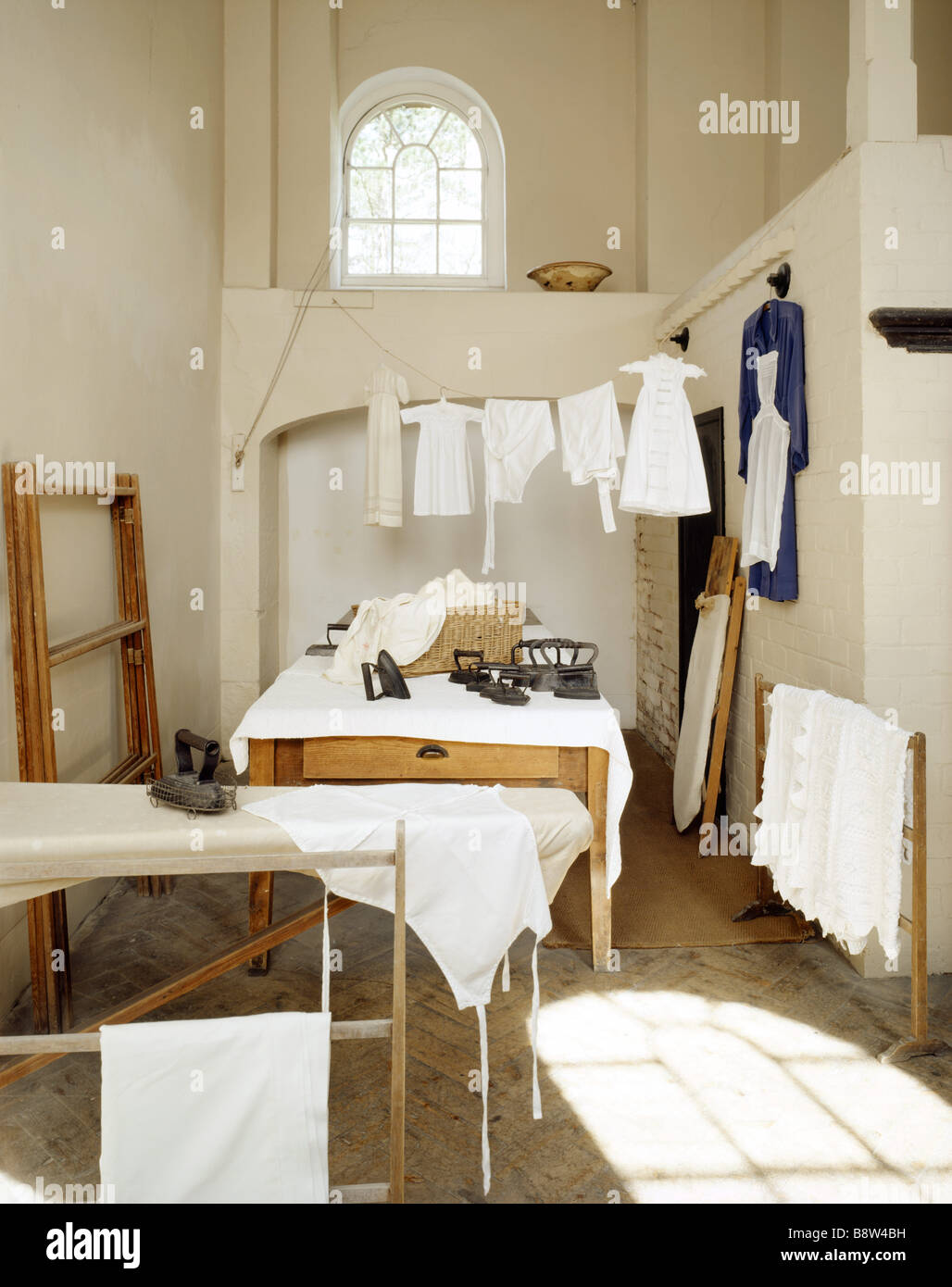 The Dry Area in the Laundry Berrington Laundry ready to be ironed irons of various sizes and ironing boards may Stock Photo