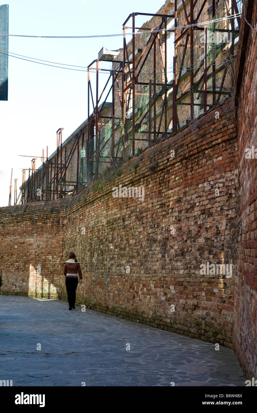 Wall behind glass factories of Murano Venetian Lagoon Veneto Italy Europe March - Stock Image