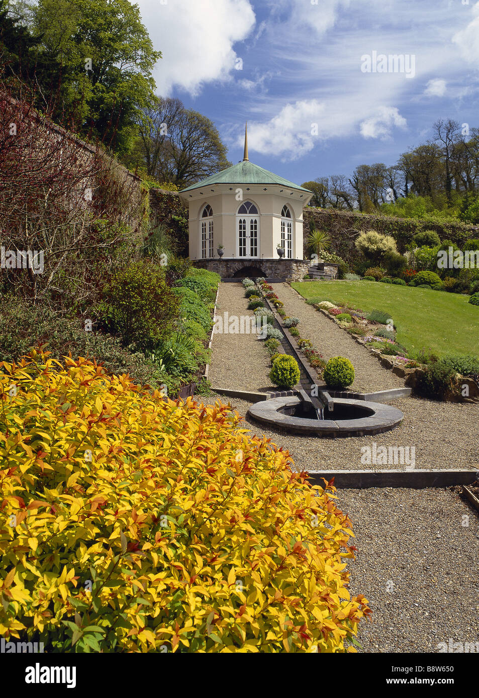 The Walled Garden with Gothic Gazebo and glorious Spirea in summer at Colby Woodland Garden - Stock Image