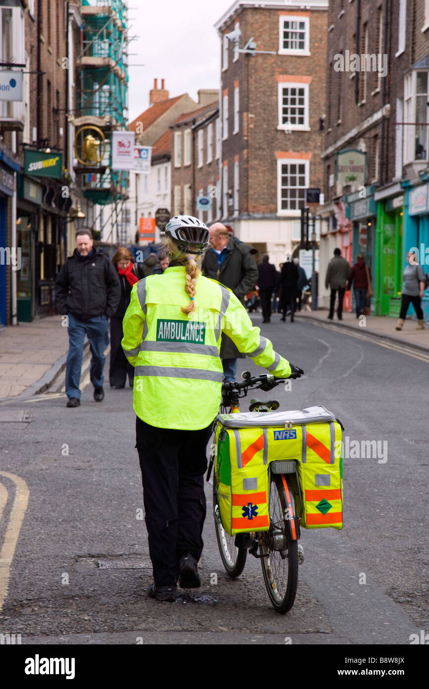 A paramedic from the York ambulance cycle response unit in York, Yorkshire. On push bike - Stock Image