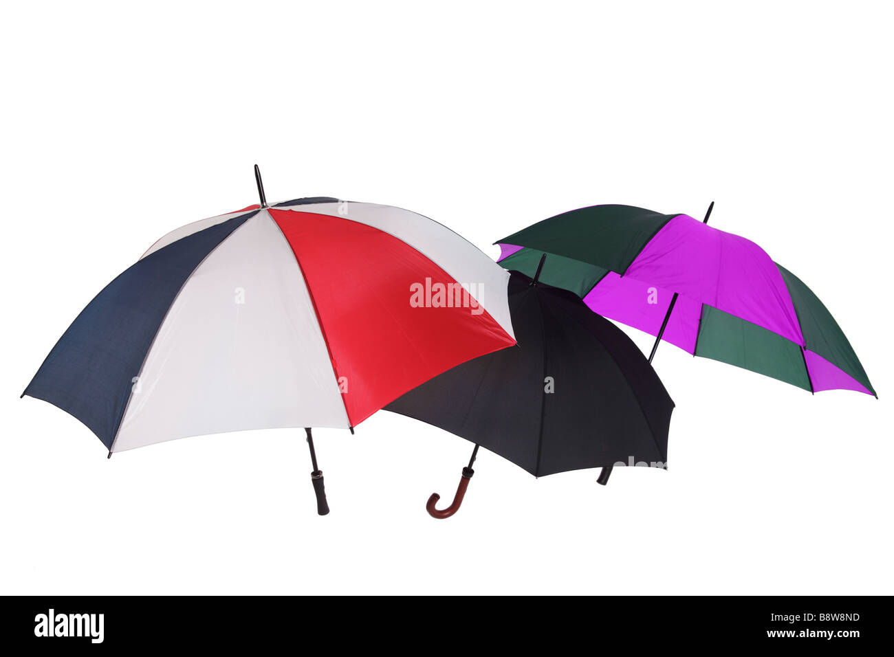 Multi coloured umbrellas isolated on a white background - Stock Image