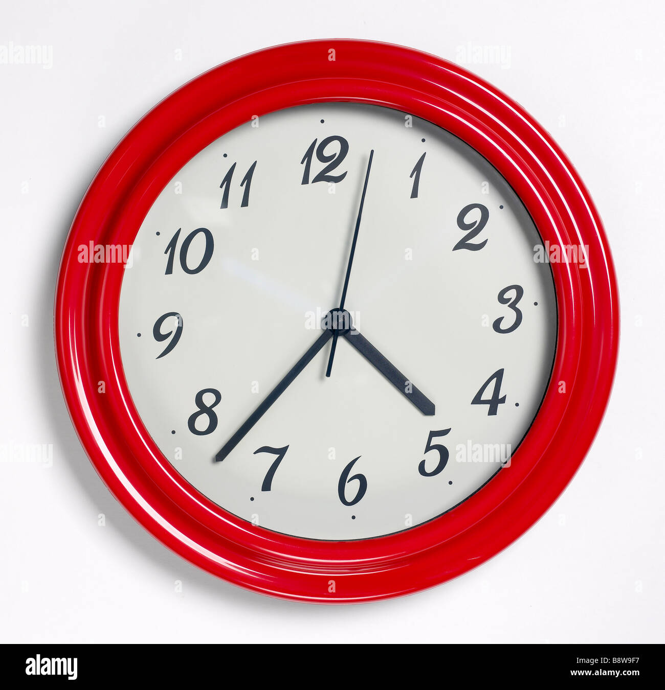 Red Wall Clock - Stock Image