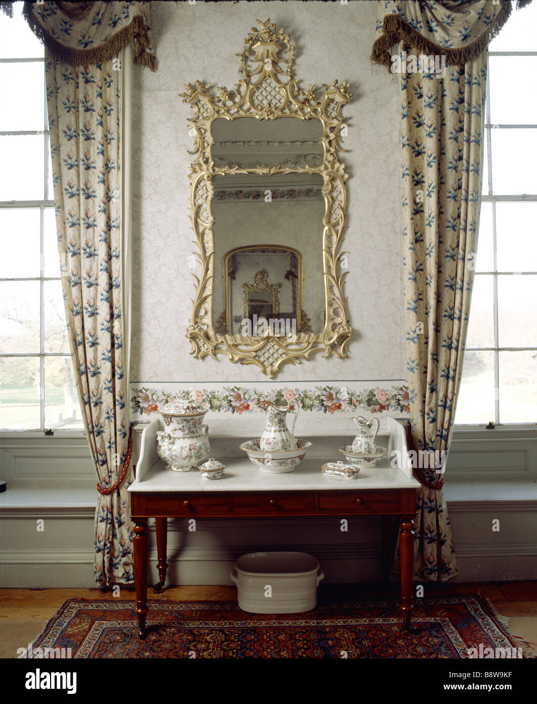 View of the mirror and wash stand in the Rose Bedroom at Felbrigg Hall Stock Photo