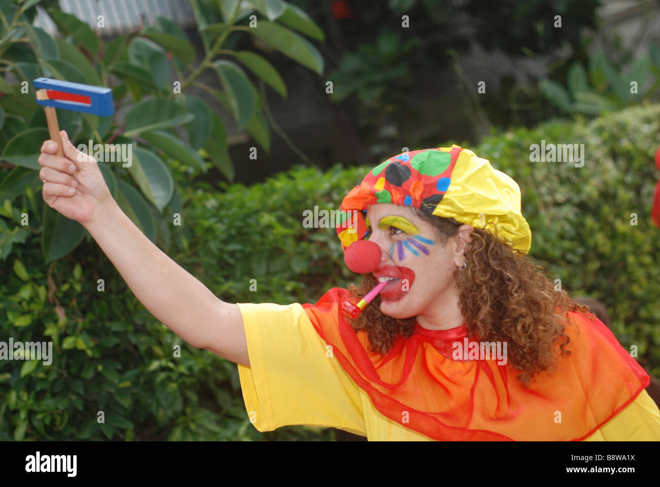 Israel Purim A young woman dressed up as a clown Stock Photo