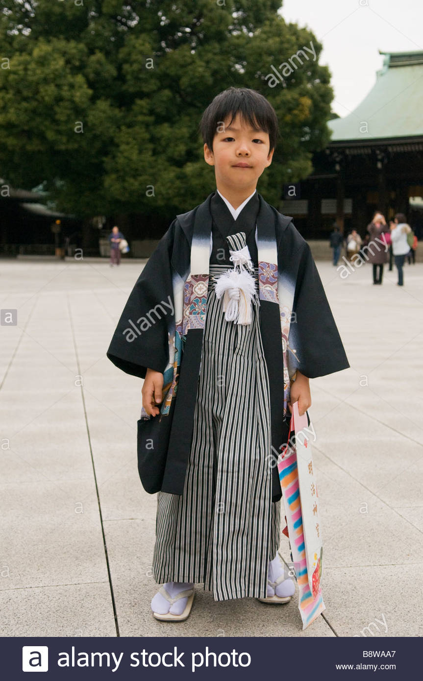 A Young Boy Dressed In A Traditional Kimono And