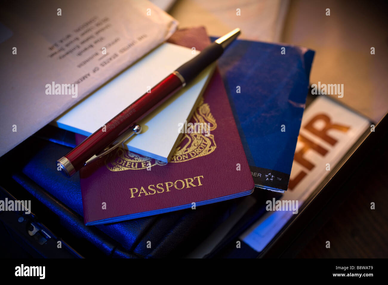 Passport Brief Case airline ticket pen visa baggage tag Hotel Isle of Wight England UK - Stock Image
