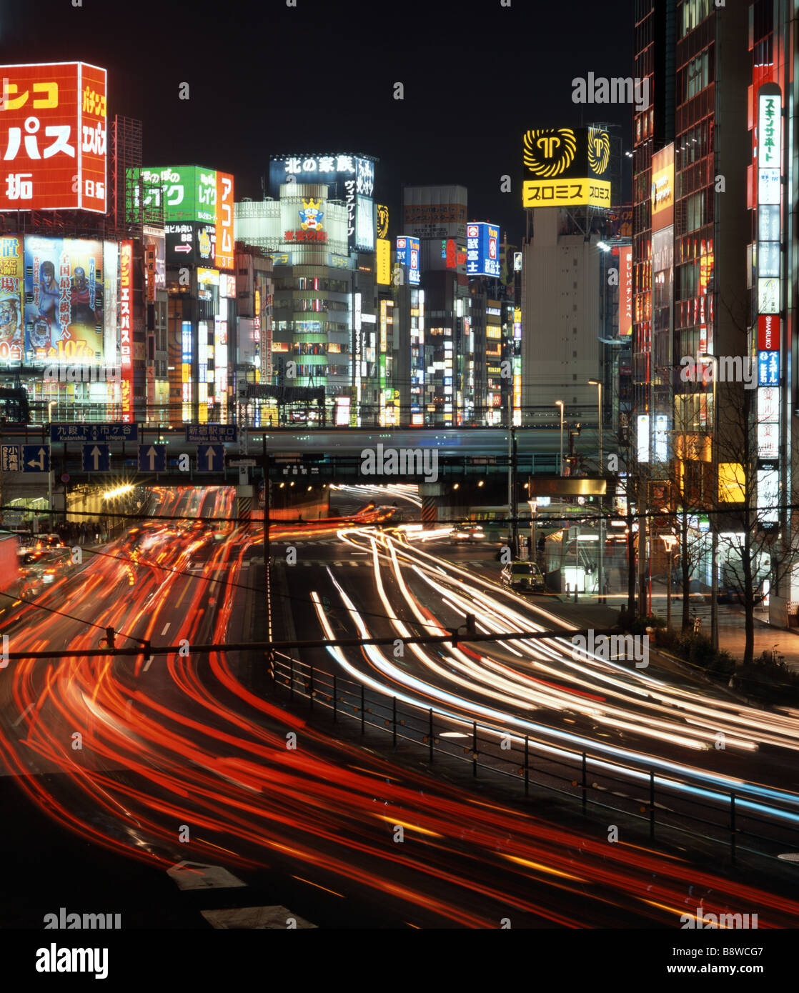 Neon lights and traffic Shinjuku - Stock Image