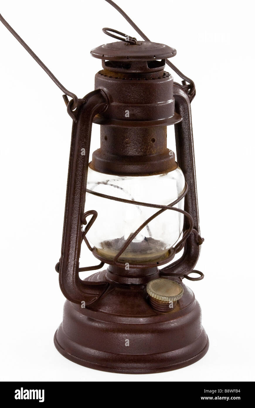 old glass kerosene lamp with a dark brown color - Stock Image
