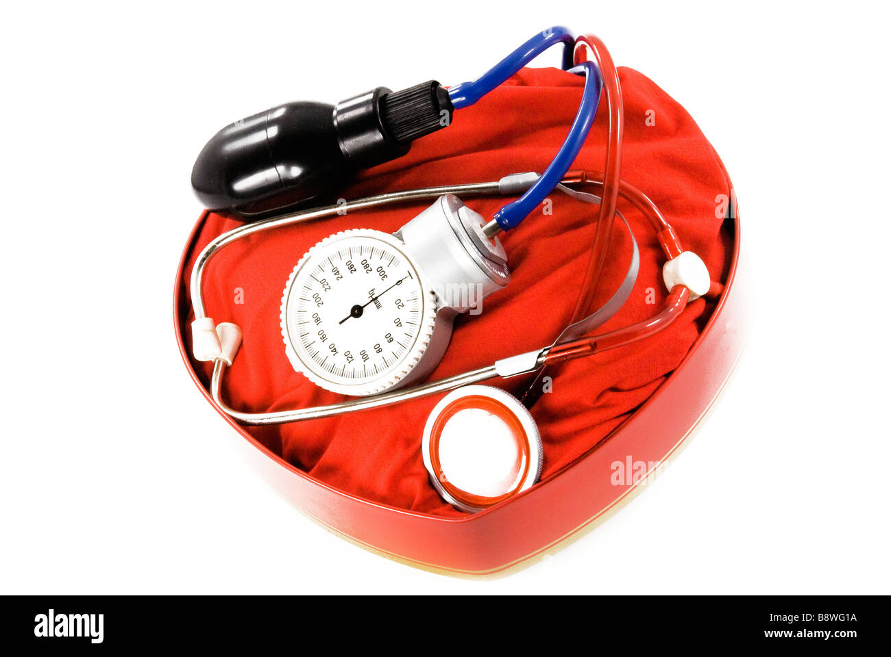 Manometer and Stethoscope pressure blood pressure packed in a box in the form of heart - Stock Image