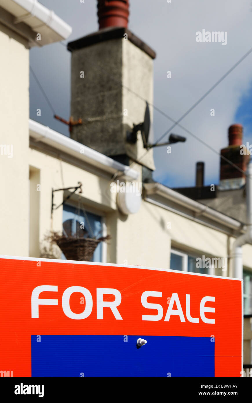 a for sale sign outside a property - Stock Image