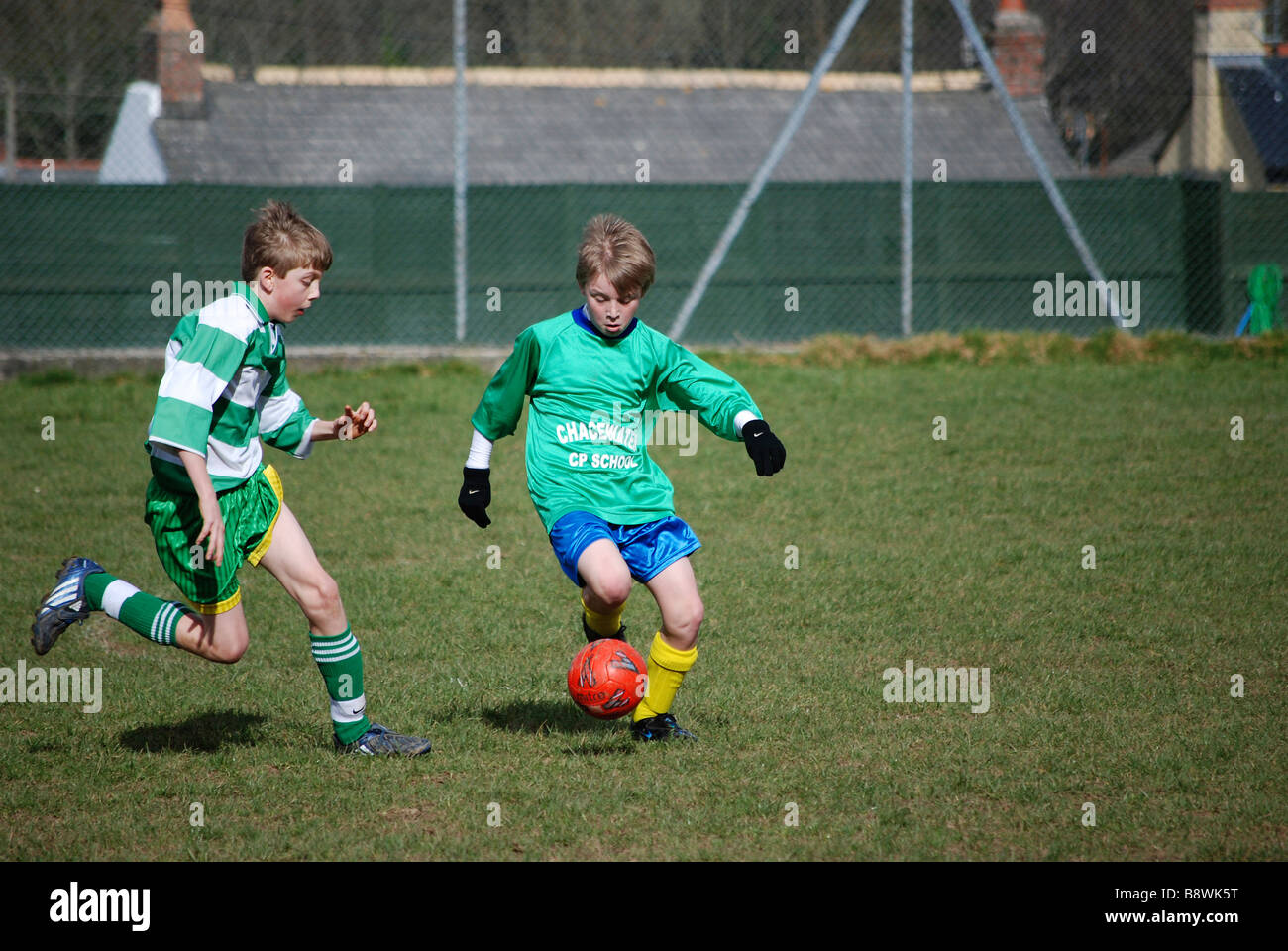 young boys playing football. uk Stock Photo