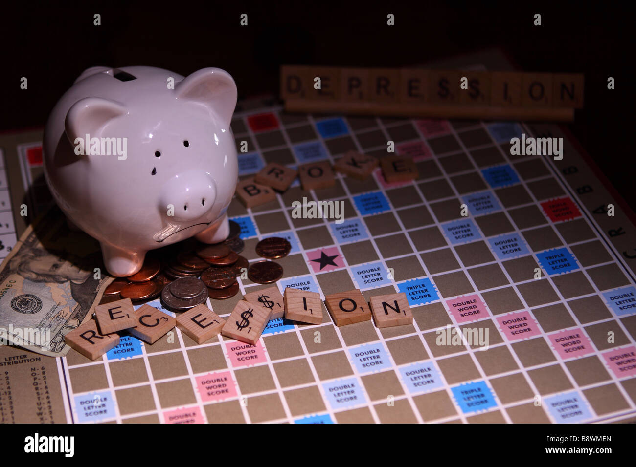 Piggy bank with game word recession and American 20 dollar bill with small coins - Stock Image