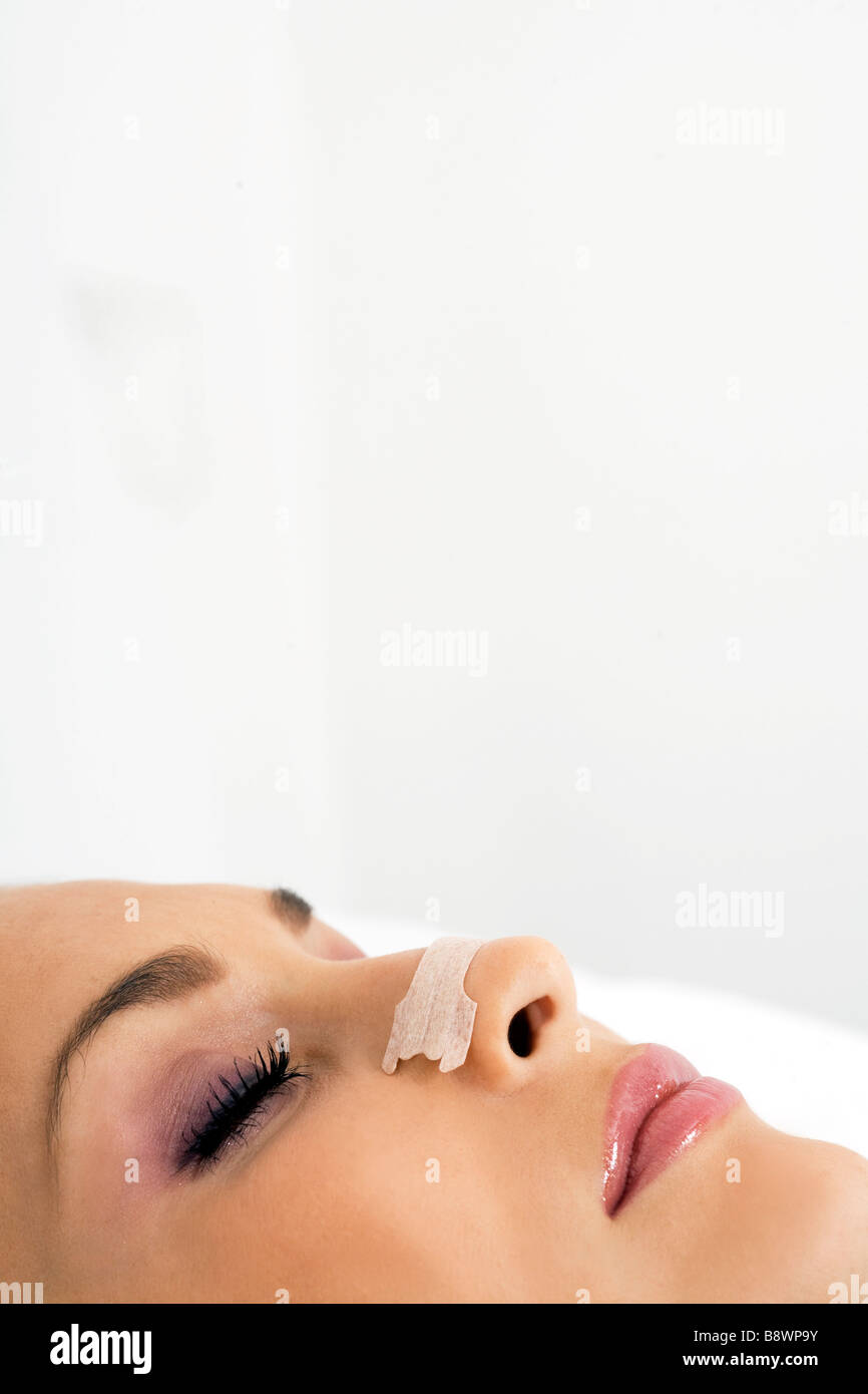 woman with plaster to breathe Stock Photo
