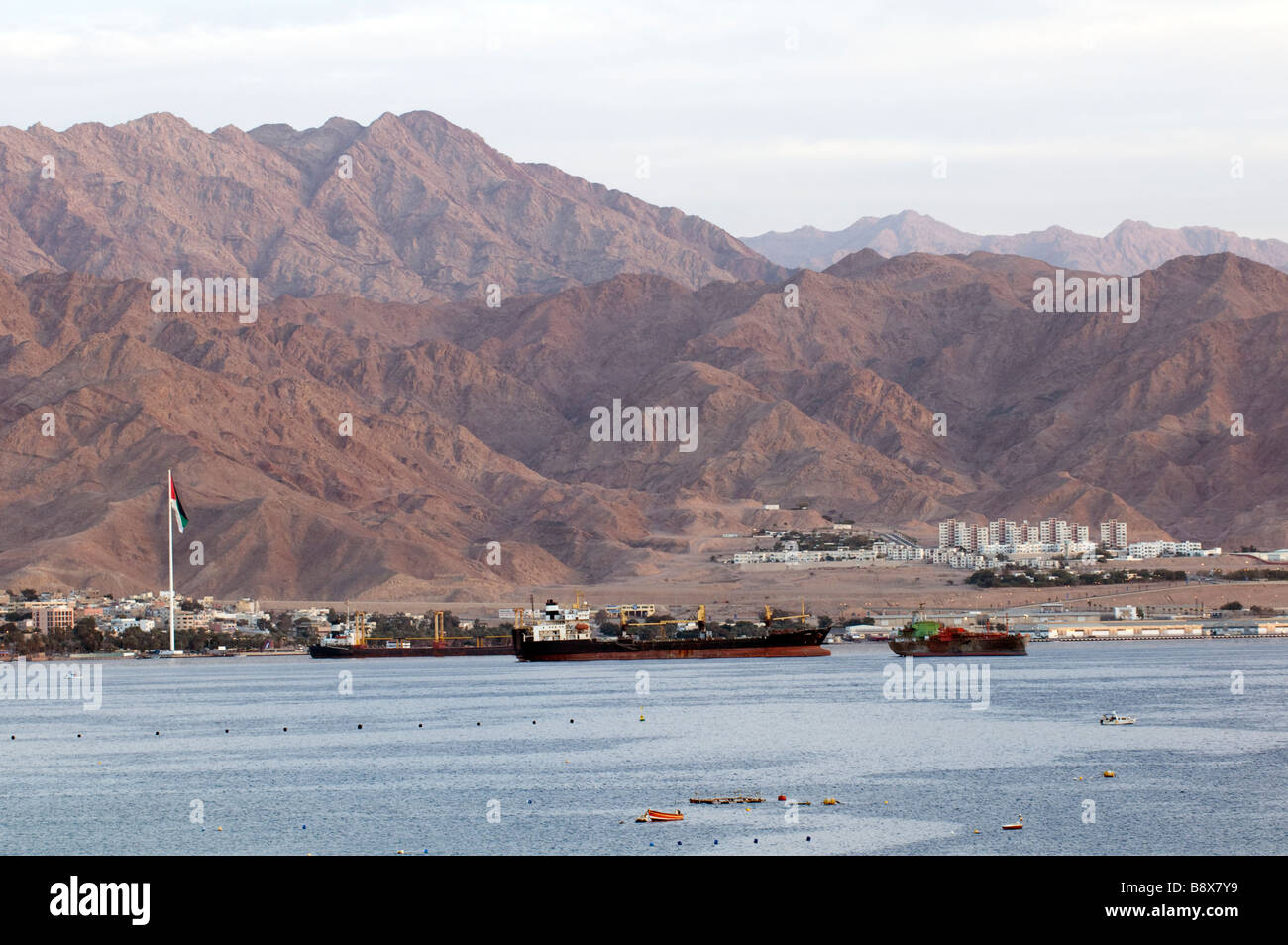The Jordanian port cityof Aqaba at dawn, viewed from Eilat - Stock Image