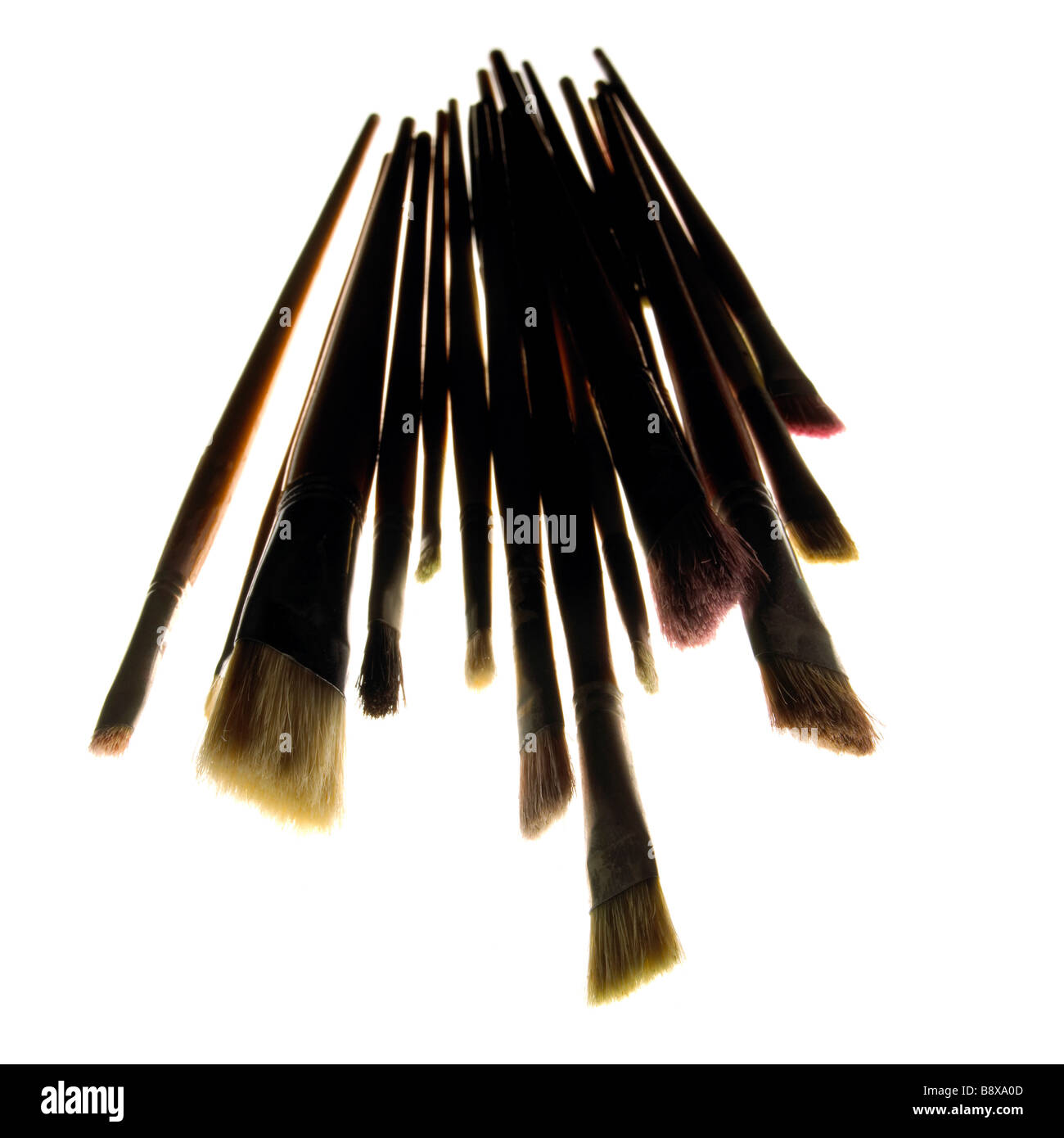 A group of used paint brushes - Stock Image