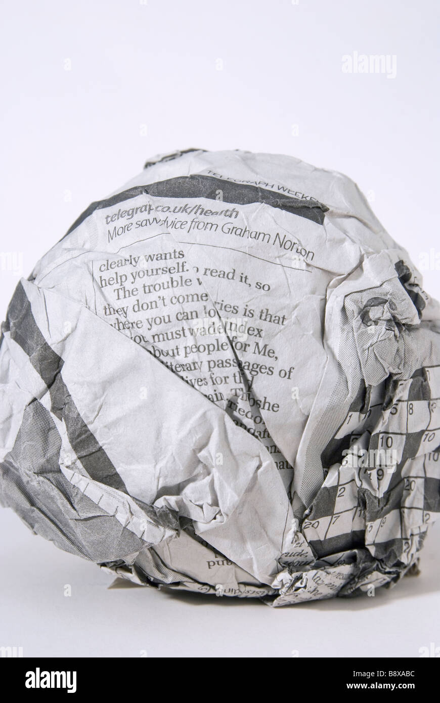 scrunched ball of newspaper - Stock Image
