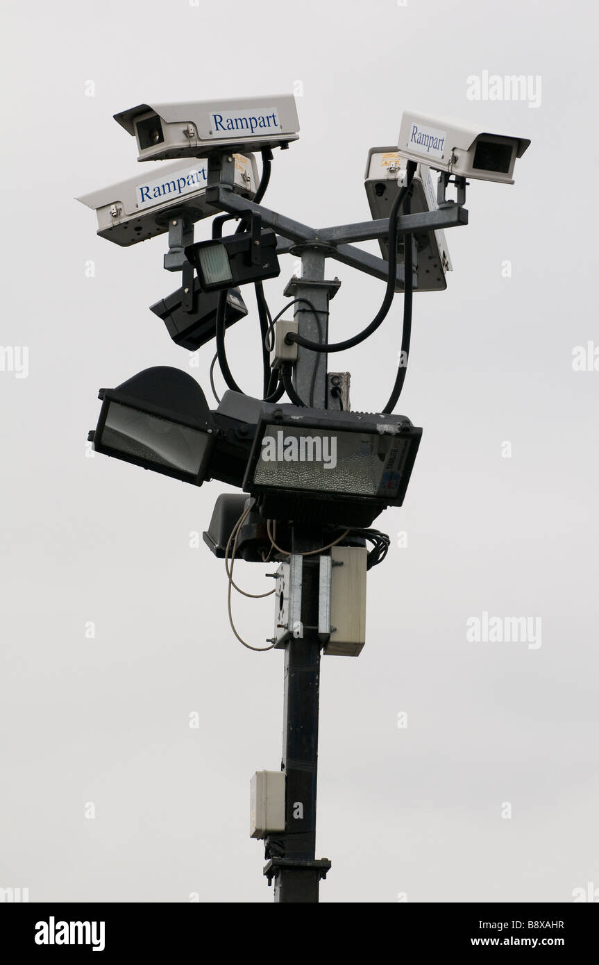 A cluster of CCTV cameras and floodlights mounted on a post in a car park in Worcestershire England UK Stock Photo