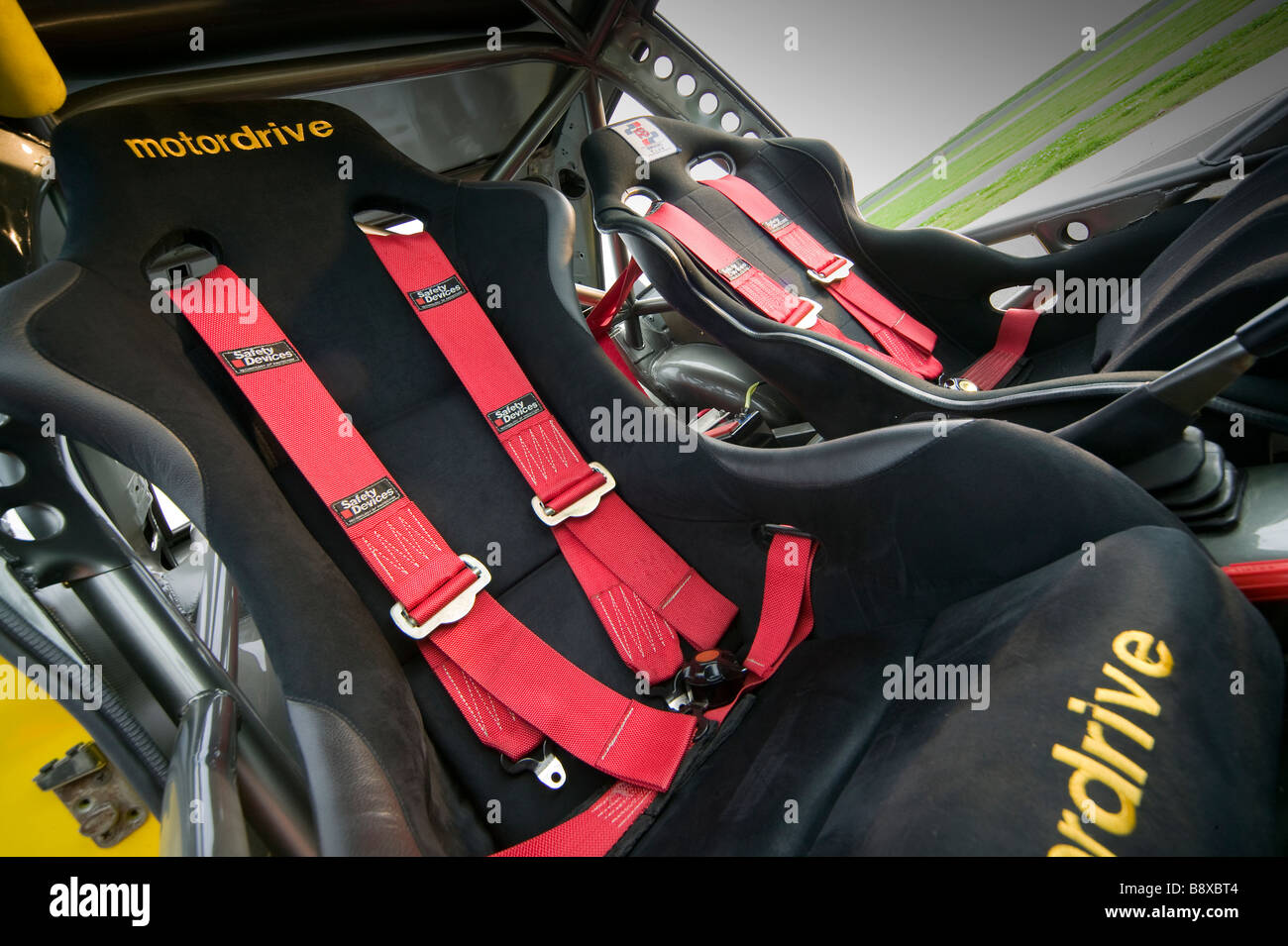 car interior showing bucket seats and racing seat belts Stock Photo