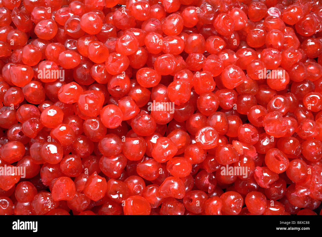 glace cherries, candy, eat, suck, chew, chewy,dentist,teeth - Stock Image