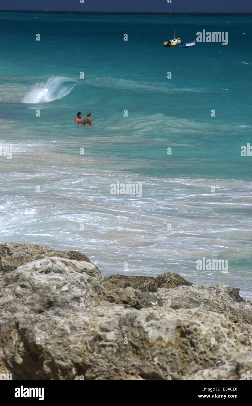 Couple in the water on Crane Beach,Barbados in the Caribbean - Stock Image