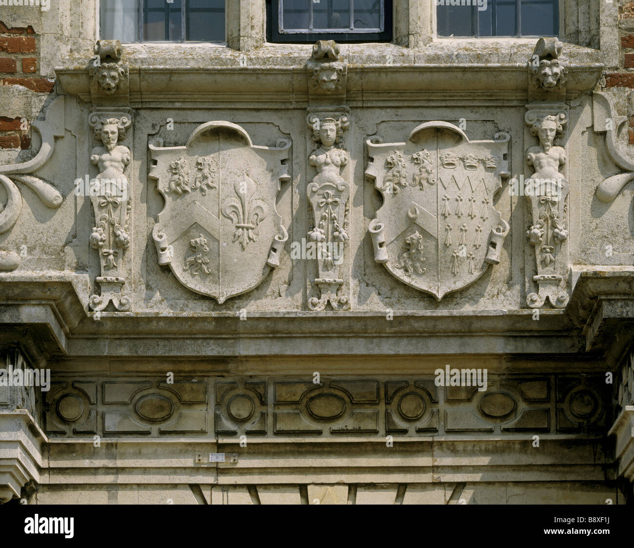 A close up view of the stone shields above the main door of the south front of Felbrigg Hall Stock Photo