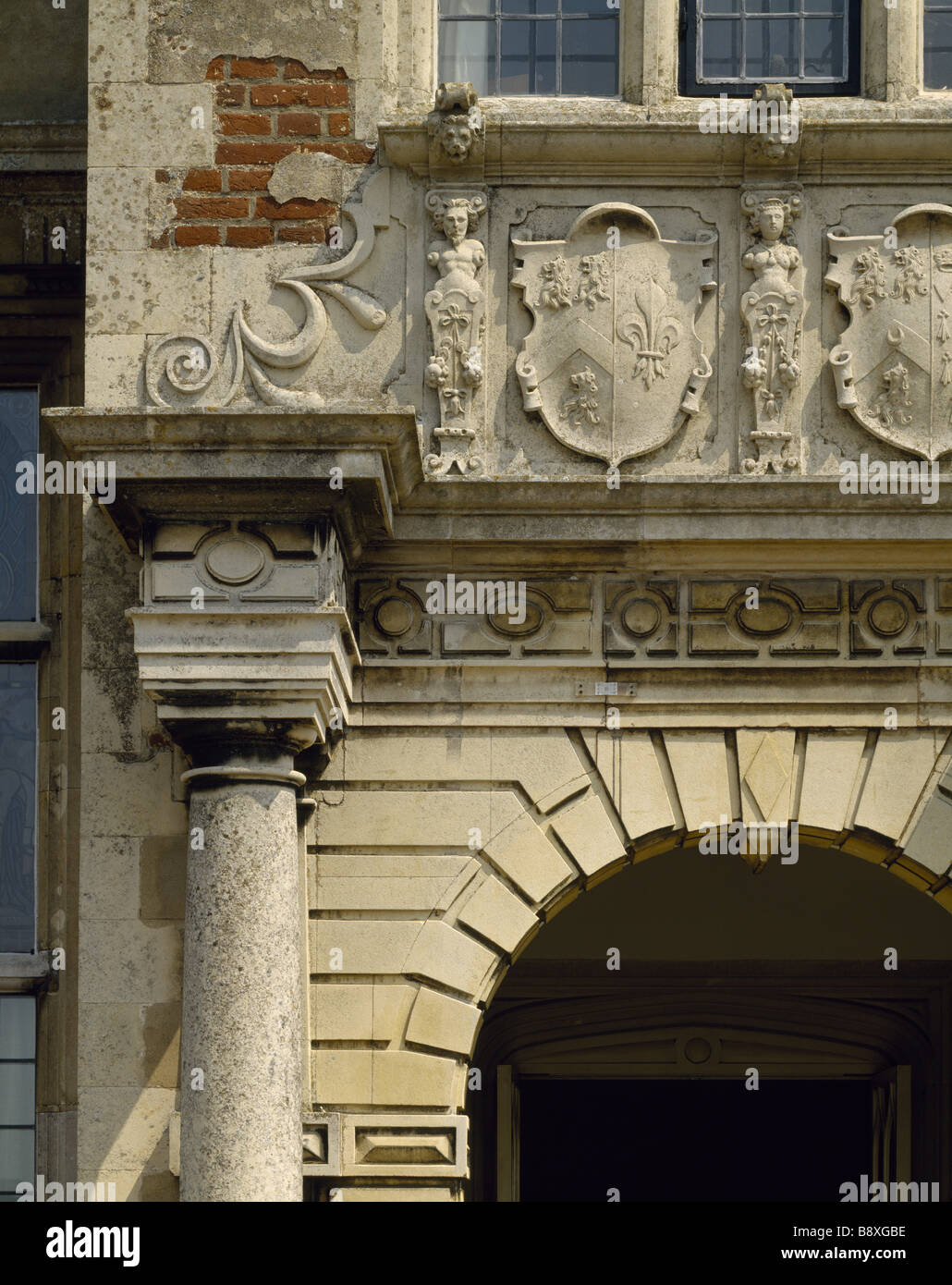 A detailed close up of part of the South Front The coat of arms above the entrance belongs to Sir John Wyndham 1558 - Stock Image
