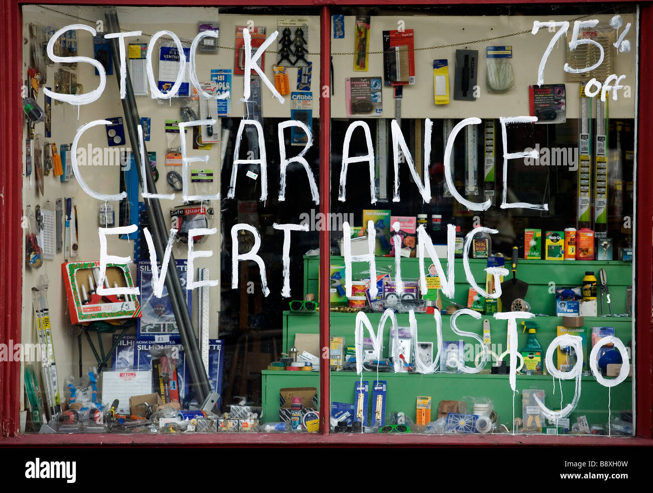 'Stock Clearance' sign in a shop window in London as the recession hits the United Kingdom, 2009. - Stock Image