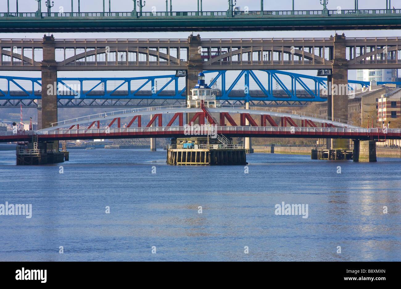 Classic view of Tyne Bridge, Swing Bridge, High level & Metro bridges spanning the River Tyne between Newcastle - Stock Image