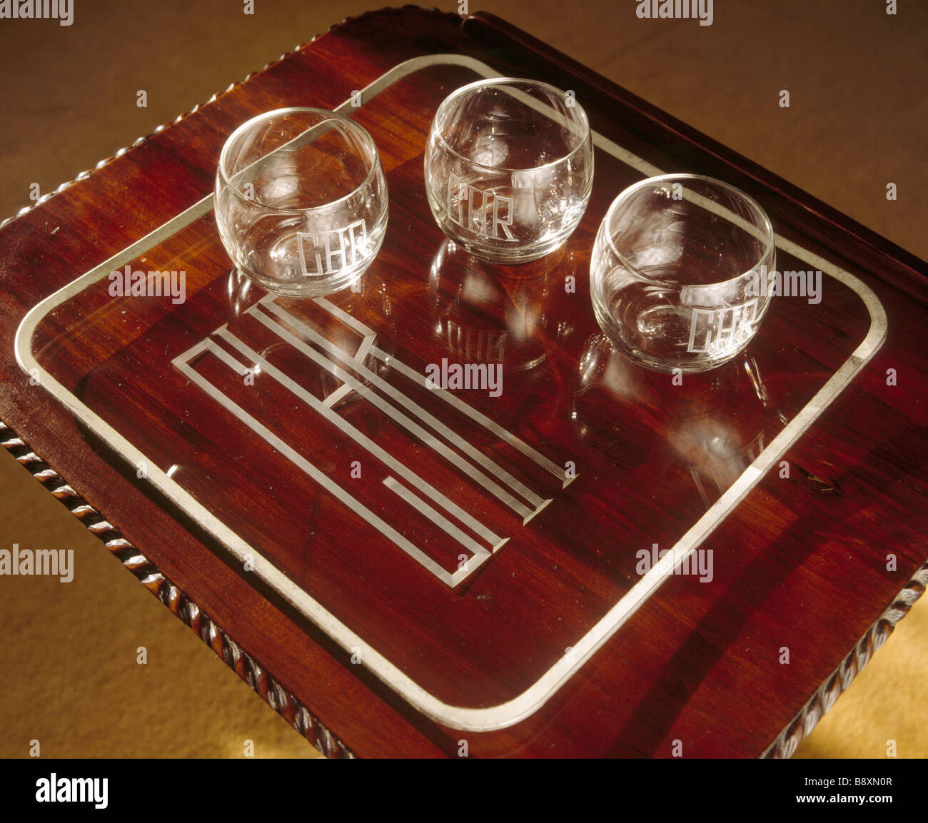 Detail of the Charles Henry Robinson monogrammed glasses on a tray in the Library at Ightham Mote Stock Photo