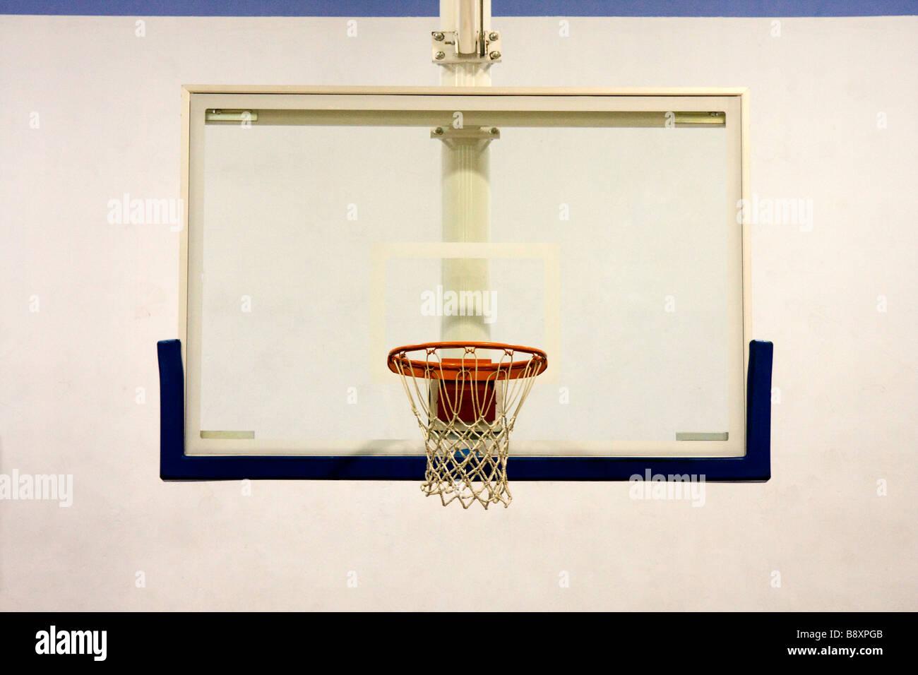 Indoor Basketball Hoop in School Gymnasium - Stock Image