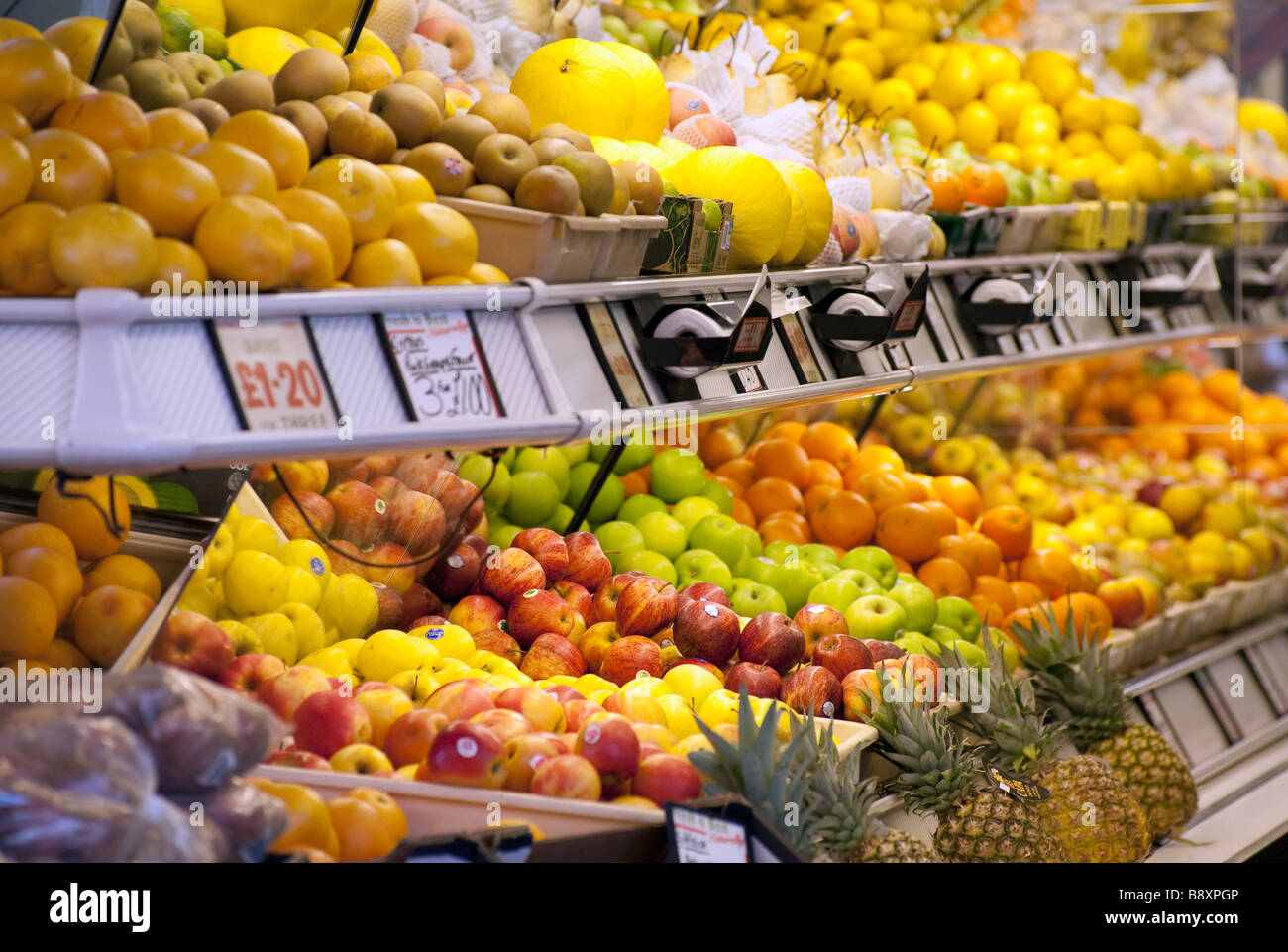 A selection of fruit inside a greengrocer's shop Stock Photo