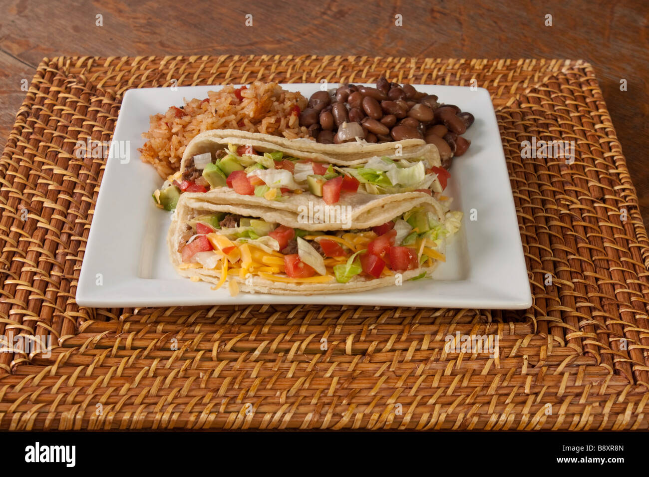 A plate of traditional style soft tacos on a bamboo charger & A plate of traditional style soft tacos on a bamboo charger Stock ...