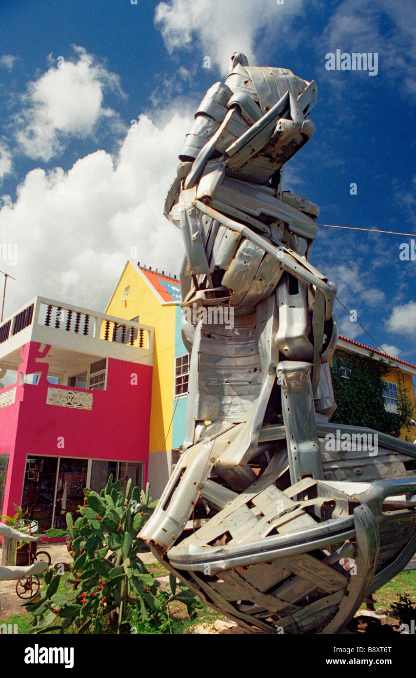 A sculpture in the back garden of well known Curacao artist Yuri Kirindongo made of recycled pieces of chrome from Stock Photo