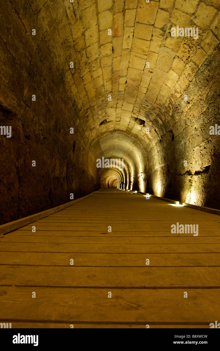 Stone masonry arch supported a secret underground Templar Knights tunnel in crusader fortress port city of Acre - Stock Image