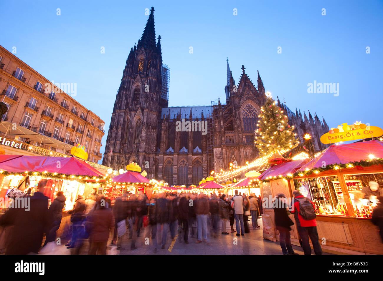 Christmas market at dusk Cologne cathedral Nordrhein Westfalen Germany - Stock Image