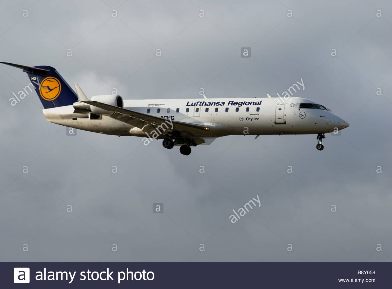 Schiphol The Netherlands Lufthansa Cityline D ACHG Canadair Regional Jet coming into land - Stock Image