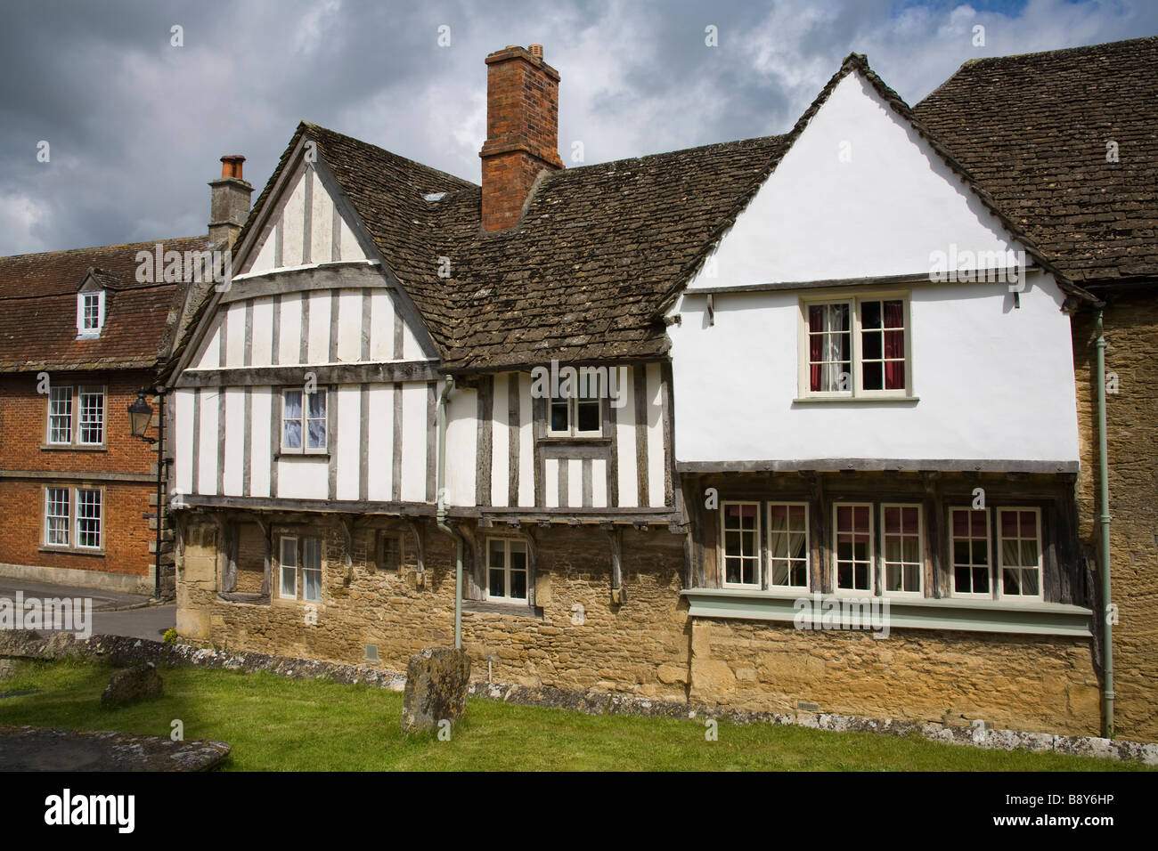 Tudor style houses in a row, Lacock, Wiltshire, England - Stock Image