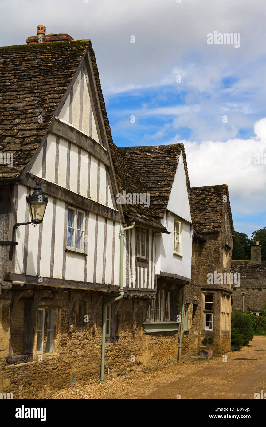 Tudor style houses in a row, Church Street, Lacock, Wiltshire, England - Stock Image
