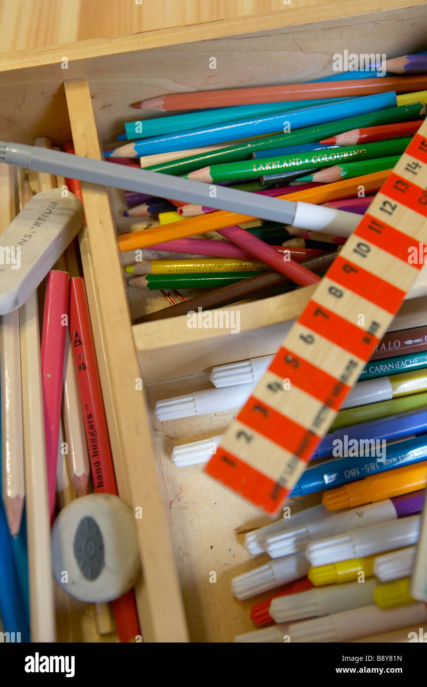 Pens, pencils, tape and rulers for school children - Stock Image