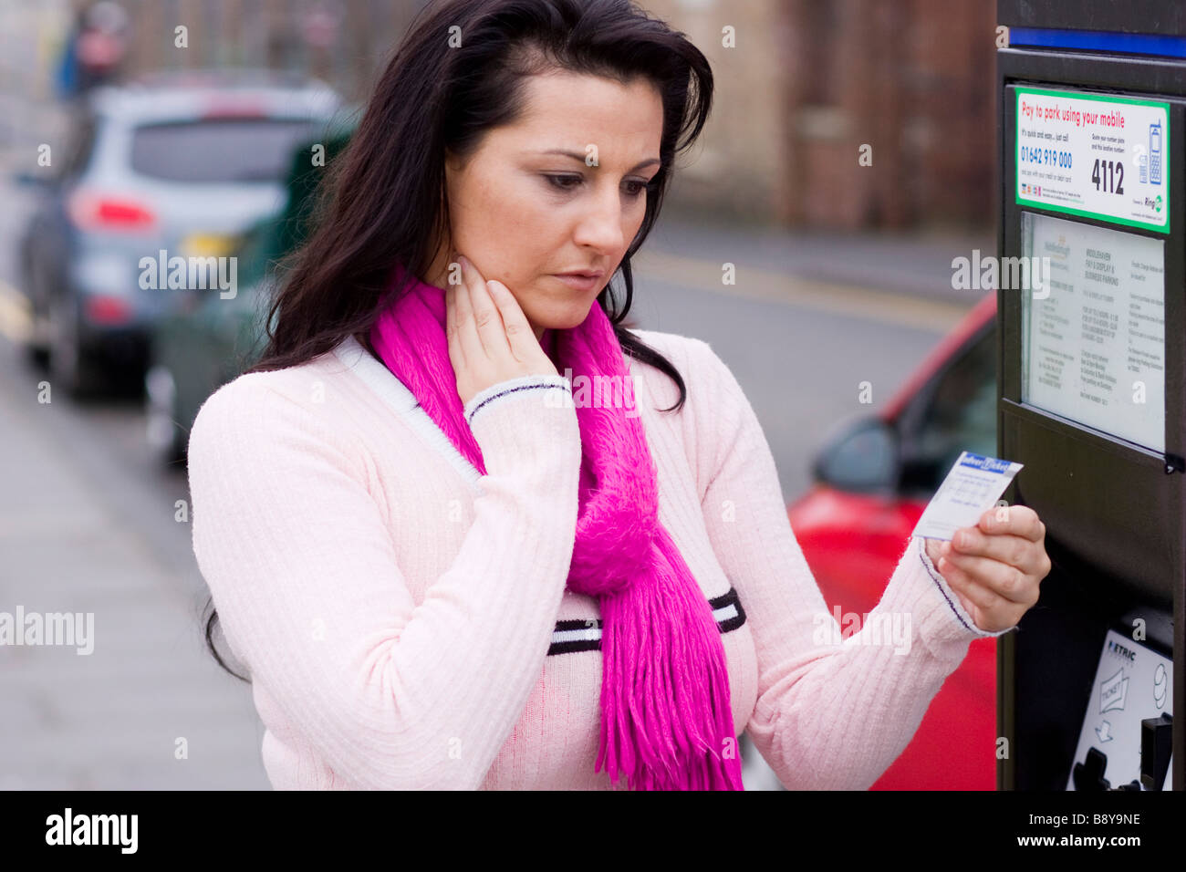 Woman with parking ticket - Stock Image